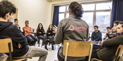 Caritas International  Between 2 worlds