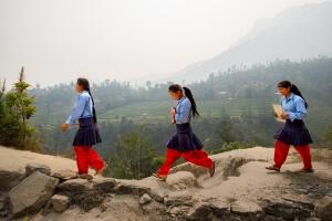 Students walking to Mahendra higher secondary school in Ichok VDC